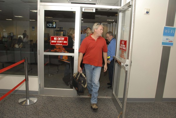 The first passengers to arrive at Bangor International Airport on the inaugural Allegiant Airlines flight from Fort Lauderdale, Fla. enter depart the secure passenger area inside the BIA domestic terminal on Nov. 17, 2011.
