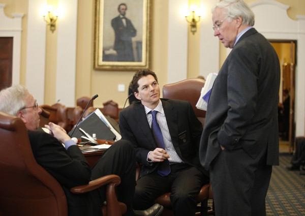 Portland Democratic Sen. Joseph Brannigan (left), and  Sen. Justin Alfond (center), D-Portland, center, speak with Rep. John Martin, D-Eagle Lake, on Wednesday at the State House in Augusta.