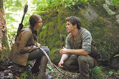 "Katniss Everdeen (Jennifer Lawrence) and Gale Hawthorne (Liam Hemsworth) in a scene from ""The Hunger Games,"" which opens in theaters on March 23."