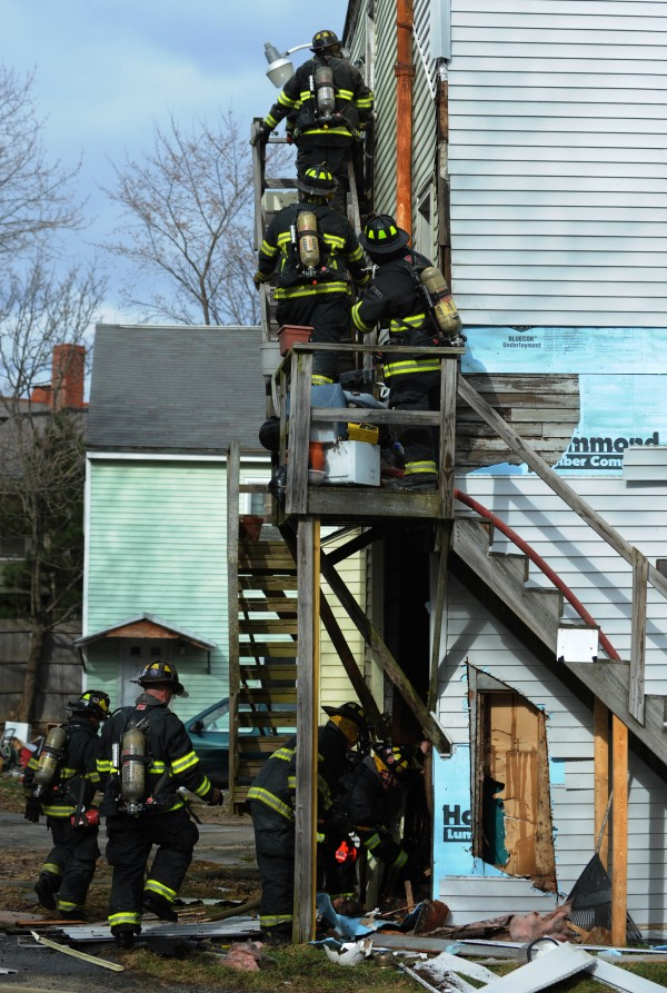 Bangor firefighters enter a house at 24 Fourth Street in Bangor on Monday, March 26, 2012.