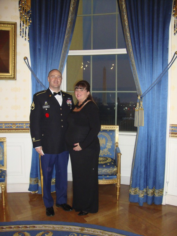 Maine Army National Guard Staff Sgt. Benjamim Straubel and his wife Robyn of Hermon in the Blue Room. The Washington Monument is in the window behind them. The two were guests at Wednesday's &quotA Nation's Gratitude: Honoring those who served in Iraqi Freedom and Operation New Dawn&quot dinner at the White House hosted by President Barack Obama and first lady Michelle Obama.