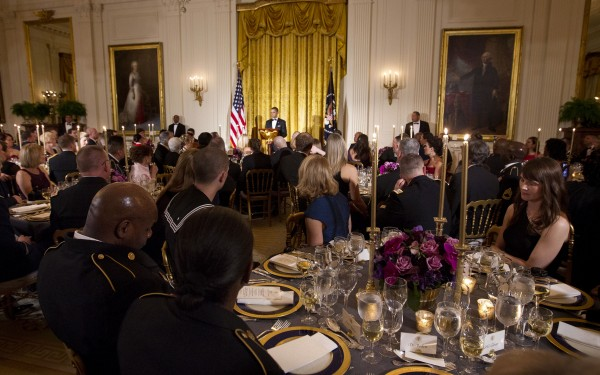 President Barack Obama speaks as he hosts a dinner for members of the U.S. military who served in Iraq in the East Room of the White House in Washington on Wednesday, Feb. 29, 2012.