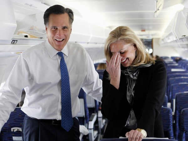 Republican presidential candidate, former Massachusetts Gov. Mitt Romney, and his wife Ann, talk to reporters on his campaign plane before taking off for Boston, in Columbus, Ohio on Tuesday, March 6, 2012.