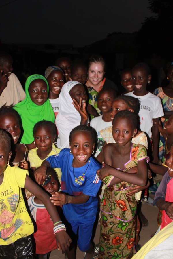 Alisa Hamilton in a crowd of kids, during the 3rd annual Gambian Youth Caravan that she covered for the Tostan blog in Africa.
