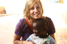 Alisa Hamilton with a new friend in one of the villages she visited during the 3rd annual Gambian Youth Caravan trip that she covered for the Tostan blog in Africa.