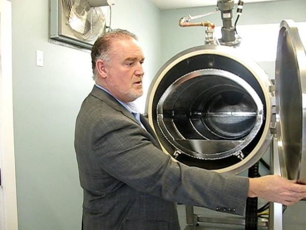 Mark Riposta, owner of the Maine Coast Crematory in Searsport, shows off his new alkaline hydrolysis machine, which he touts as a more environmentally friendly way of disposing of bodies, on Thursday, March 22, 2012.