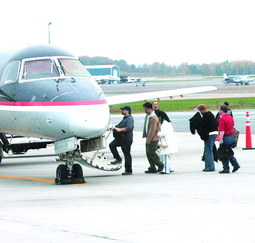 Passengers board a regional jet at Bangor International Airport.