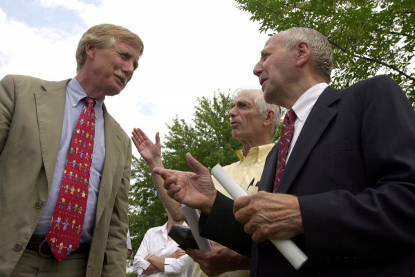 During the Downeast Heritage Center groundbreaking ceremony Monday, Aug. 5, 2002, Edmund DelMonaco (from right) and Harold Silverman talk to Gov. Angus King about the placement of a visitor information center at the site of the new bridge between Calais and St. Stephen, New Brunswick.