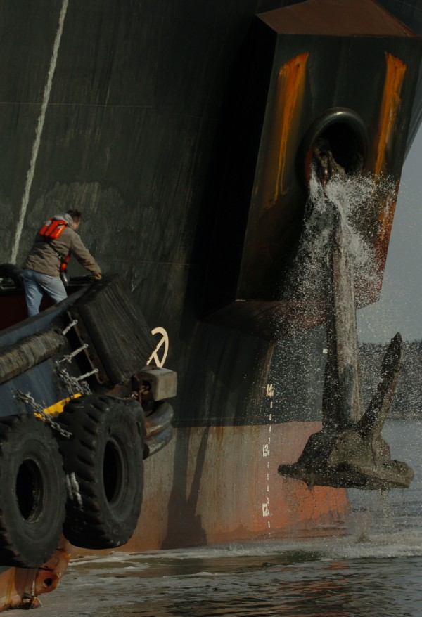 A crew member aboard the tugboat Fournier Tractor watches as the massive anchor on the Baldock is pulled up Jan. 24, 2008, after the ship spent the night anchored in Penobscot Bay.