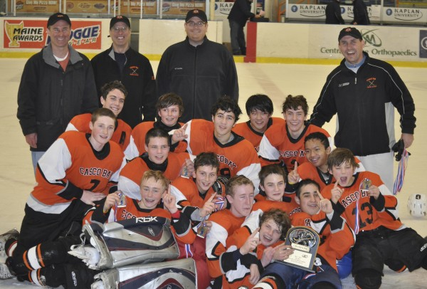 Players and coaches of the Casco Bay Tier II bantams celebrate Feb. 26 after defeating the Maine Freeze 1-0 in the state championship game at the Colisee in Lewiston. Casco Bay advanced to the national tournament March 28-April 1 in Wayne, N.J.