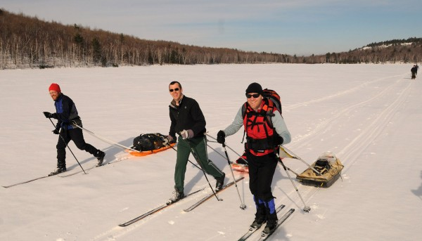 Glen Widmer (from left), Stan Farrell and A. Roy Curtis ski under crisp sunshine and on great trail conditions on the ice of Lower South Branch Pond in Baxter State Park on Friday Feb. 24, 2012.