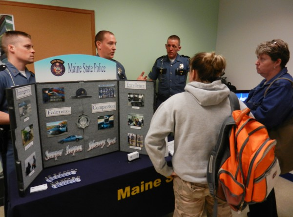 The Maine State Police were one of 36 agencies and businesses represented at the second annual Beal College Career Fair in Bangor Wednesday. Troopers Brian Bean and Michael Johnston (left and middle, respectively), and Cpl. Jason Madore answer questions from Beal students Amanda Kowalsky (left) and Cindy Johnson (right) in one of the rooms used to host the fair.