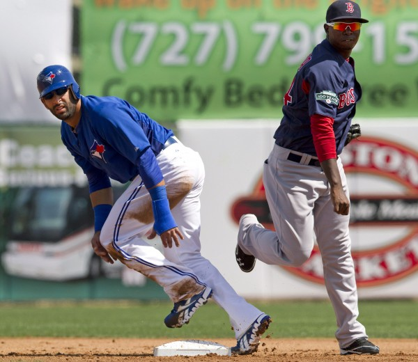 Boston Red Sox second baseman Oscar Tejada, right, and Toronto Blue Jays' Jose Bautista watch the throw on a double play during the first inning of a spring training baseball game in Dunedin, Fla. on Wednesday, March 7, 2012.