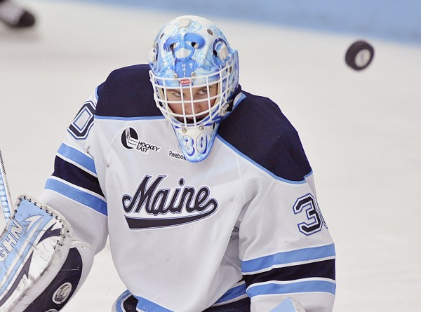 Maine goalie Dan Sullivan watches the puck after a stick save in the third period of their NCAA college hockey game against Boston College in January 2012 in Orono.