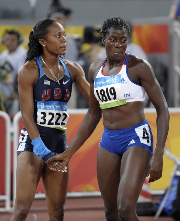 In this Aug. 19, 2008, file photo, bronze medalist Sanya Richards, left, of the United States, and gold medalist Christine Ohuruogu, of Britain, shake hands after the women's 400-meter final during the athletics competitions at the Olympics in Beijing. The British team has been advised by its top doctor to avoid shaking hands with rivals and visiting dignitaries at the London Games this summer. The reason: Olympic germs could cost Olympic gold.
