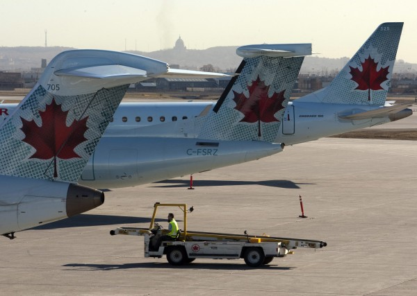 Air Canada planes sit on the tarmac as many baggage handlers walked off the job at Pierre Trudeau airport Friday, March 23, 2012, in Montreal. A wildcat strike by Air Canada ground workers that started in Toronto and spread to other airports ended Friday, several hours after Canada's largest airline was forced to cancel more than two dozen flights. (AP Photo/The Canadian Press, Ryan Remiorz)
