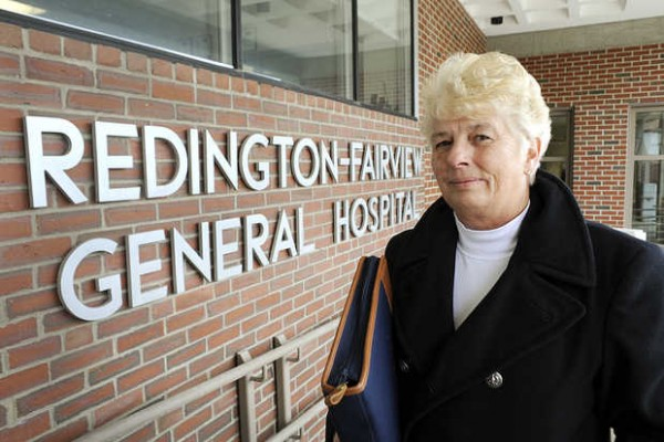 Joanne Woodard of Skowhegan, pictured at the entrance to Redington-Fairview General Hospital in Skowhegan, is upset about the high compensation package of the hospital's CEO.
