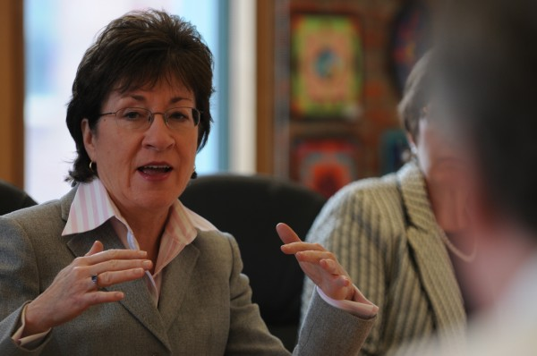 Sen. Susan Collins asks a question of the staff at the Eastern Maine Development Center in Bangor.