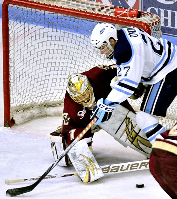 Maine's Will O'Neill falls into Boston College's John Muse while looking for a rebound during a game last season. O'Neill has signed a contract with the NHL's Winnipeg Jets.