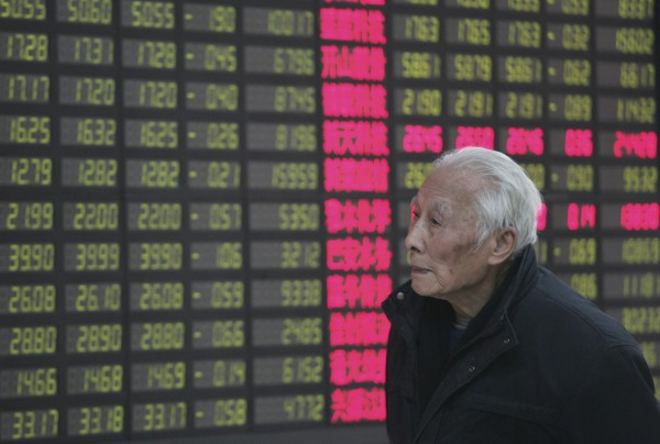 An investor looks at the stock price monitor at a private securities company in Shanghai, China, Tuesday March 6, 2012. Asian stock markets slid Tuesday over worries about slower economic growth in China and a possible snag in the deal for Greece to get its bailout money. Mainland China's Shanghai Composite Index fell 1 percent to 2,417.29. (AP Photo)