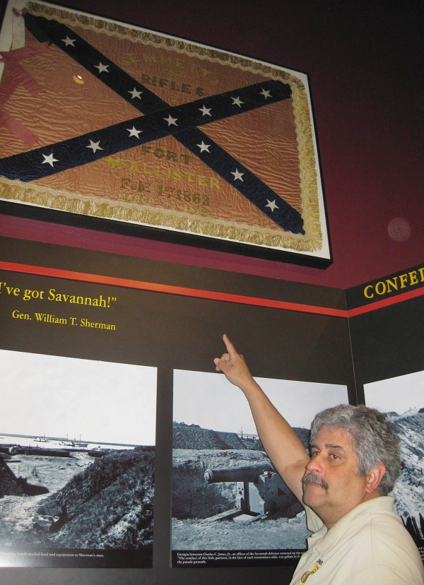 In this Wednesday, March 21, 2012 photo, Fort McAllister state park manager in seen in Richmond, Ga., Daniel Brown points to the Civil War site''s latest find — a Confederate unit's flag that was captured as the fort fell to Gen. William T. Sherman''s troops in 1864.