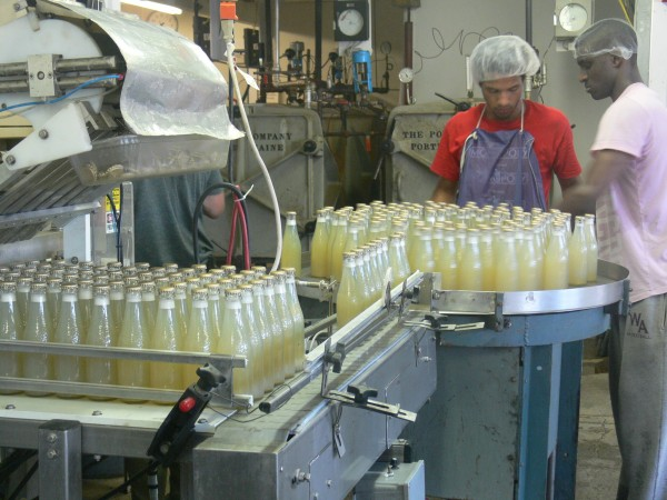 Workers run a line of clam juice through the bottling plant at Look's Gourmet Food Co. in Whiting.