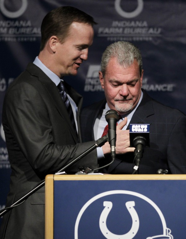Indianapolis Colts owner Jim Irsay, right, hugs quarterback Peyton Manning after announcing that the NFL football team will release Manning during a news conference in Indianapolis, Wednesday, March 7, 2012. Manning, 35, who missed all of last season after a series of operations on his neck, has been the staring quarterback for 13 season, won a record four MVP's and the 2006 Super Bowl.