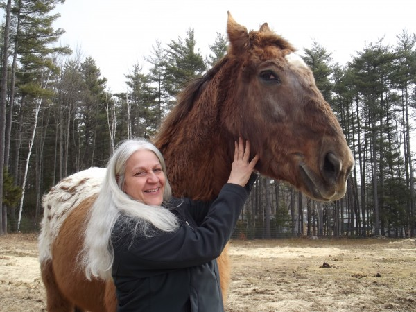 Andrea Mietkiewicz of Old Town shows off the newly healed wound on her 28-year-old horse named Coach on Sunday, March 18, 2012. Sometime around the New Year, Coach was struck by an apparent shot from a BB gun, causing a small wound that later became infected and nearly forced Mietkiewicz to put the horse down. Coach has made a stunning recovery and is returning to his normal self, according to Mietkiewicz.