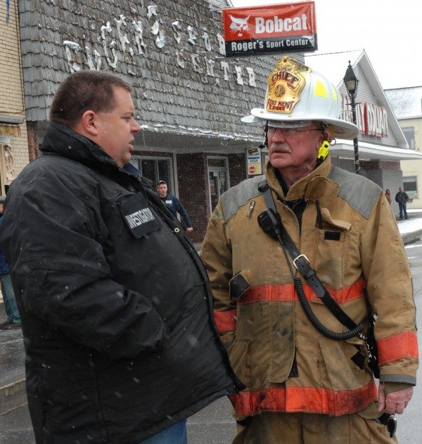 Investigator with the Maine fire marshal's office Tim Lowell (left) was in Fort Kent Sunday following the early morning blaze that claimed three West Main Street buildings and left close to a dozen people homeless. No one was injured in the fire and the cause remains under investigation. While in Fort Kent, Lowell met with Fort Kent Fire Chief Edward Endee (right).