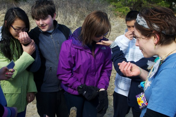 Ferry Beach Ecology School instructor Hannah Wilhem (right) has her students from Portland's Lincoln Middle School sniff a soil sample taken in a marsh on the banks of the Saco River Monday March 26, 2012. Students are (from left) Leinani Farnsworth, 13, Patrick Crnogorac, 13, Sydnie Lowry, 12, and Alex Nim, 13.