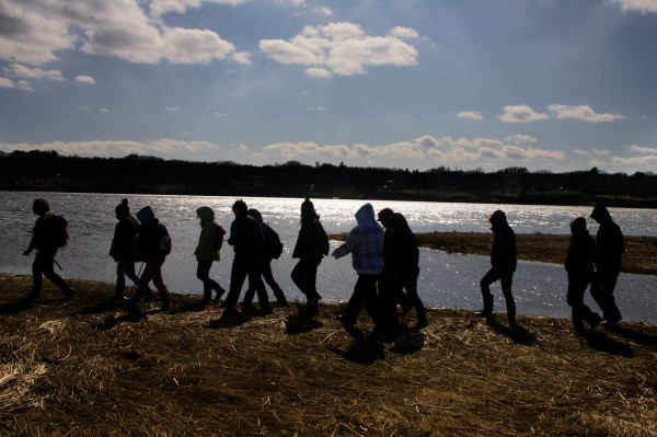 Hannah Wilhelm (far left) leads a group of seventh-graders from Portland's Lincoln Middle School in a trek through a salt marsh on the banks of the Saco River in Saco Monday, March 26, 2012, at the Ferry Beach Ecology School.