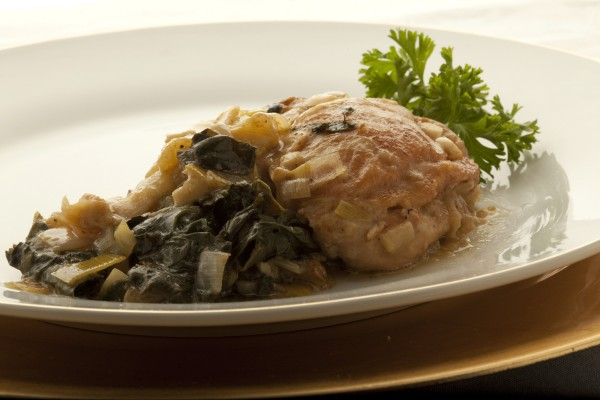 Braised chicken with leek, spincach and apples is part of a menu inspired by meals servedon the Titanic.