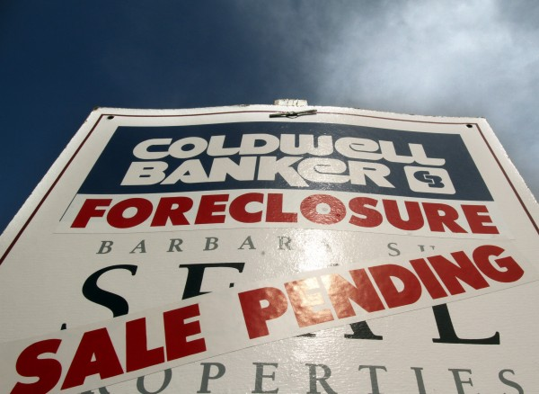 A foreclosure sign stands in front of a home in Oregon in 2011.