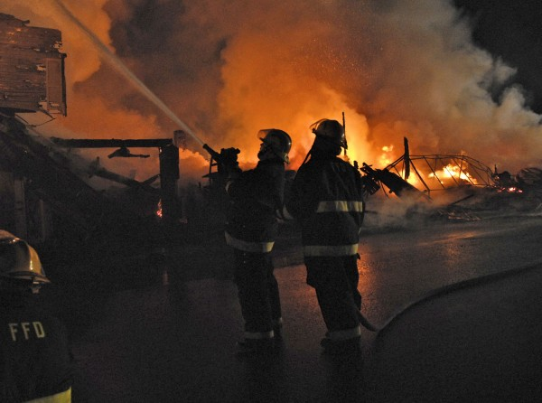 Firefighters from eight departments from Maine and New Brunswick responded to a major fire in downtown Fort Kent early Sunday morning, March 25, 2012.