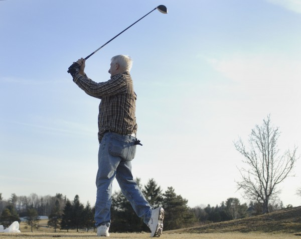 Jim Treadwell gets in some practice with his &quotsecret weapon&quot driver at the Penobscot Valley Country Club in Orono, Maine, on Monday, March 12, 2012.