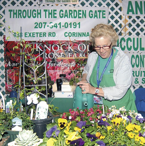 An exhibitor gives flowers a fresh drink of water at Bangor's Garden Show in 2011. Last year's show brought more than 8,000 people to the Bangor Civic Center and Auditorium to welcome spring. Demonstrations, competitions, events for kids, and an Easter bonnet contest will draw a wide variety of visitors to the show.