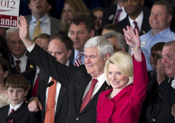 Republican presidential candidate, former House Speaker Newt Gingrich (left) and his wife Callista wave as they arrive for a Super Tuesday rally on Tuesday, March 6, 2012 in Atlanta.