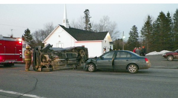 A Caribou woman was injured late Tuesday evening after two cars collided on U.S. Route 1.