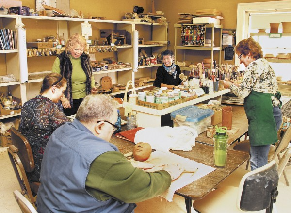 Arts and crafts are very popular at the Center. Here, members work on clay projects. Pottery, painting, sewing, and computer classes are just some of the many other events held regularly, many of which are free (as is Center membership). Visitors come to read, play cribbage or bridge, socialize, and even put on plays.