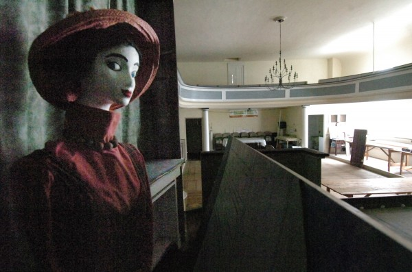 A mannequin, dressed in Victorian-era costume, graces the stage of Harmony Hall in Hampden, Maine. A restoration effort is under way for Harmony Hall in Hampden, which was originally the Universalist Church, built in 1828.