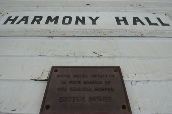 Aging placards grace the front of Harmony Hall in Hampden, Maine. A restoration effort is under way for Harmony Hall, formerly the Universalist Church, built in 1828, and purchased by the Hampden Garden Club in 1966.