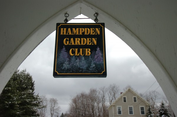 The Hampden Garden Club sign graces the front entrance for Harmony Hall in Hampden, Maine. A restoration effort is under way for the meeting place, formerly the Universalist Church, built in 1828. The building was purchased by the Hampden Garden Club in 1966.