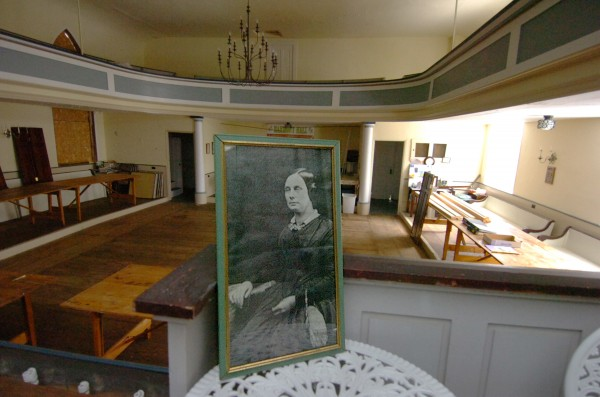 A portrait of famous suffragist Susan B. Anthony resides in Harmony Hall in Hampden, Maine. Anthony is reported to have spoken there in 1898. A restoration effort is under way for Harmony Hall in Hampden, formerly the Universalist Church, built in 1828. It was purchased by the Hampden Garden Club in 1966.