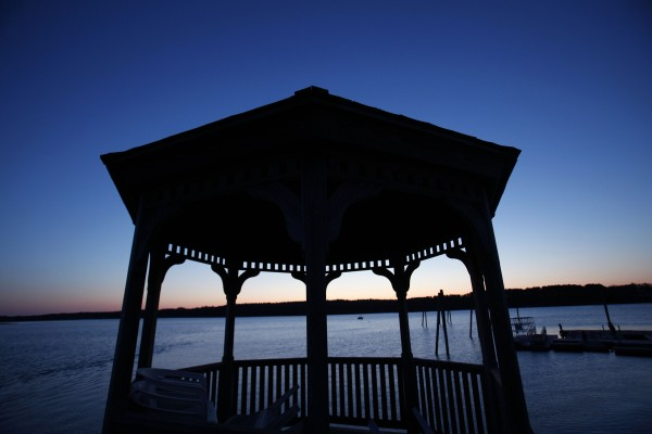 A gazebo overlooks the Harraseeket River in Freeport where just a single boat is moored for the winter.
