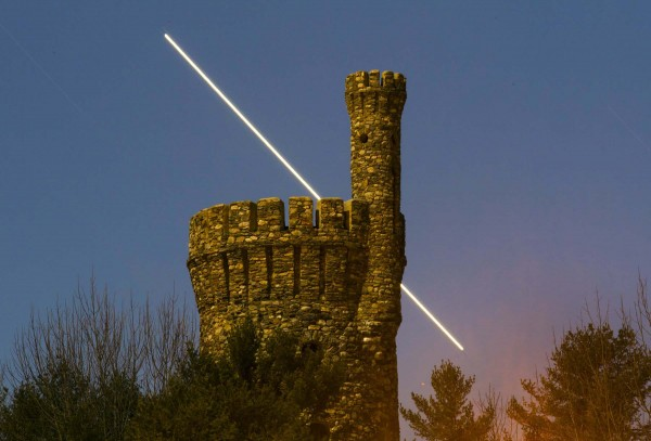 A 13-minute time exposure shows the path of the planet Jupiter as it sets behind the stone tower of the Casco Castle on a hill overlooking Harraseeket River in Freeport. The main building of the castle burned down in 1912.