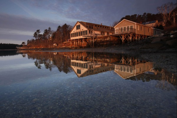 The Harraseeket Boathouse and Cottages bask in the first light of day on the shore of the Harraseeket River in Freeport.