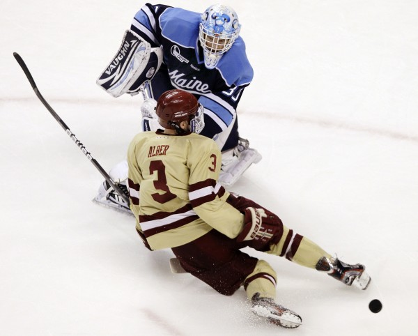 Maine goaltender Dan Sullivan comes out from the crease to defend against Boston College's Patch Alber as the puck gets away from him in the first period of the Hockey East final in Boston, Saturday, March 17, 2012.