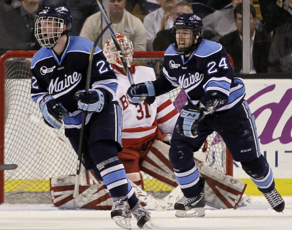 Maine's Stu Higgins (22) and Mark Anthoine (24) celebrate a goal by teammate Will O'Neill as Boston goaltender Kieran Millan (31) reacts in their Hockey East semifinal in Boston on March 16. Higgins and Anthoine will return for the Bears next season.