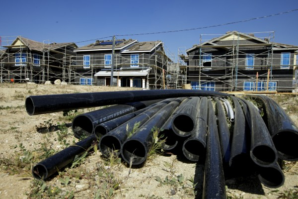 In this photo taken Thursday, March 15, 2012, PVC pipes are seen next to new single-family detached homes being built by Lennar at the &quotAria at West Creek&quot development in Santa Clarita, Calif.  U.S. builders started work on slightly fewer homes in February, but they began preparing for what could be the healthiest spring buying season since the housing bubble burst. (AP Photo/Damian Dovarganes)