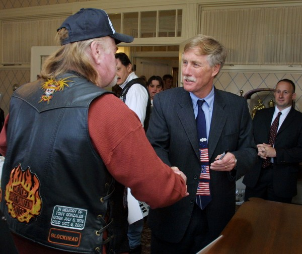 Gov. Angus King greets an unidentified motorcycle enthusiast Wednesday, May 1, 2002, at the Blaine House in Augusta during King's annual Governor's Tea with members of United Bikers of Maine. Various speakers discussed the need for educating people on motorcycle safety.